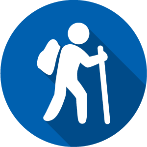 Icon of a hiker, white on a blue circle