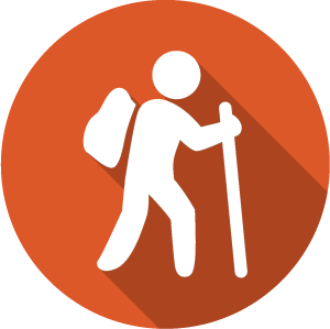 An icon of a hiker, white on an orange circle