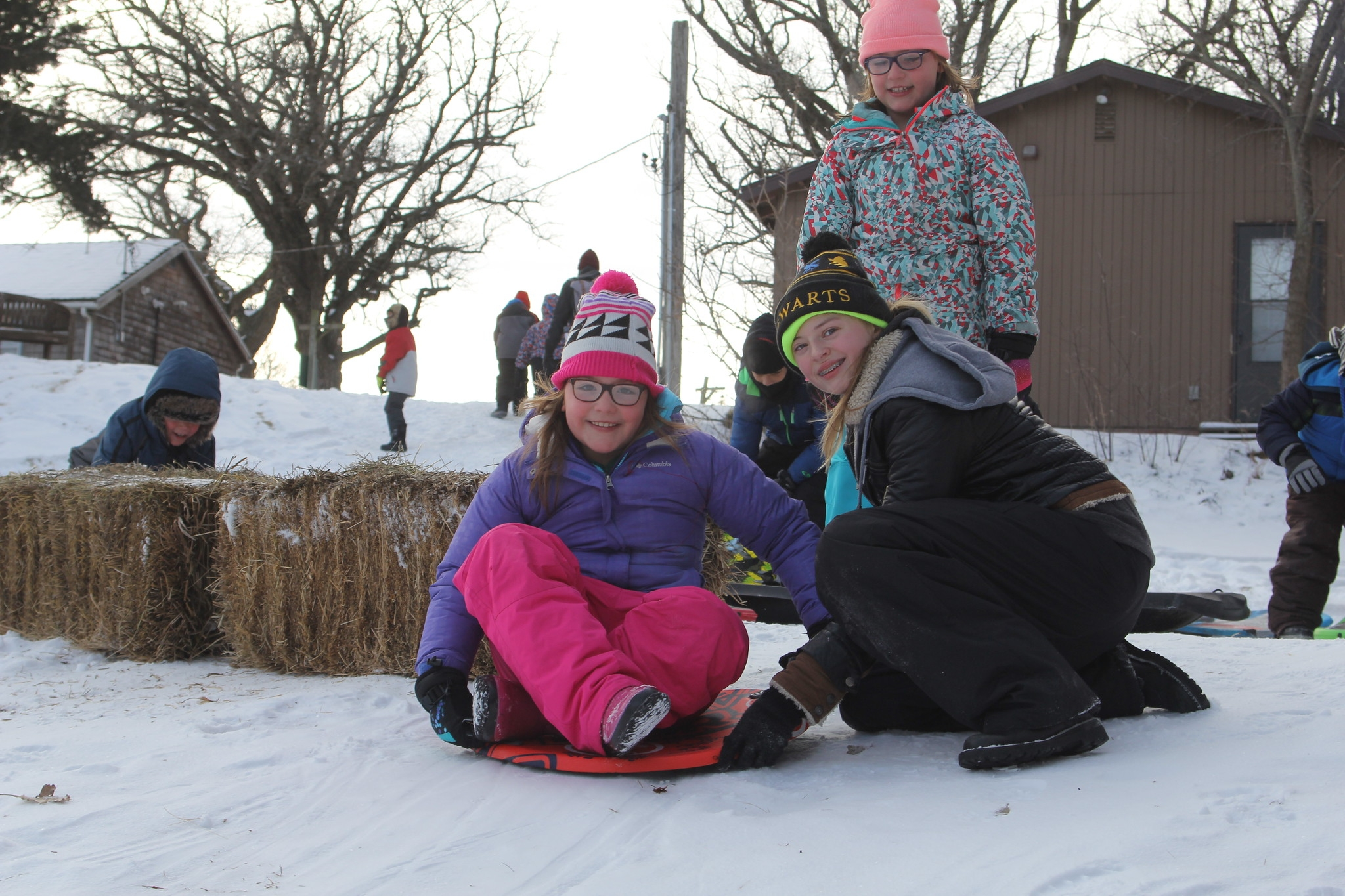 A camper poses on a disk sled just before taking off with assistance from an SK