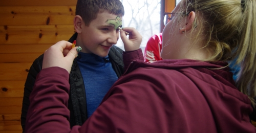 A camper gets his face painted